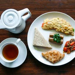 english breakfast with a cup of a tea